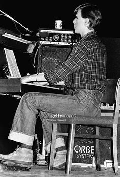 David Bowie performs on stage playing keyboards on Iggy Pop's The Idiot tour at the Rainbow Theatre, London, March 1977.