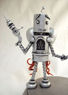 One of my cool, wood made robot wedding cake toppers, this time in an old school, maybe 1950's style retro design, finished in metallic silver. They're holding hands, and his rocket jet pack is flaming up, ready to go off and carry them to the starts       Wood toys for kids, and why I stopped buying electronic toys.     Here's a great selection of DIY wooden toys, downloadable plans and instructions. Make your kids happy!! http://www.woodendesignplans.com/toys-plans/