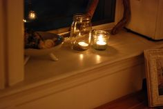 Mason jars hold candles for a zero waste party decoration (no need to buy special votive holders!)