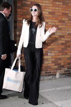 Anne Hathaway - like the wide legged pants & the light jacket - - great sunnies too but def not conservative