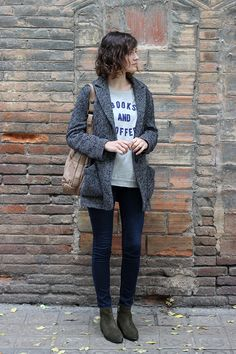 'Books and Coffee' shirt, herringbone jacket, boots.