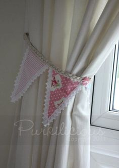 Beautiful bunting curtain tie-back by Purkilicious