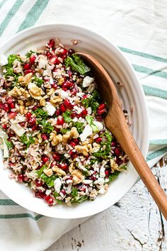 A deliciously tangy, chilled wild rice and pomegranate salad with kale, red onion, feta, walnuts, basil, and orange champagne vinaigrette. Great for healthy make-ahead lunches and a dish to pass at potlucks.