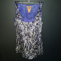 Tory Burch Top This is a Tory Burch Sleeveless  Top.  Its a size 6 and its really Hot.  Its got the white and black on grey and the signature Tory Burch geometric pattern except with leaves.  So its got the pattern and the natural look that Tory Burch is known for.  Sure to catch many compliments and Then you can say.....yes its Tory Burch; ) Tory Burch Tops Blouses
