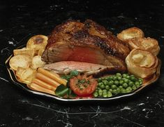 Traditional Sunday roast.  Roast beef and yorkshire pudding - don't forget the horseradish sauce!