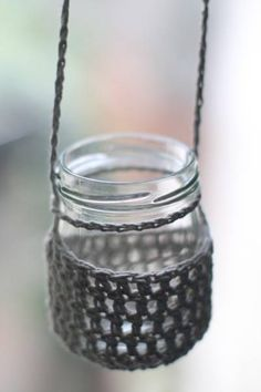 If you've recycled a bunch of mismatched jars and want them to look like a set then some crochet jar cozies could be what you need. This one comes from a set over at Outside My Window.