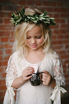 flower girl with eucalyptus crown // photo by Nicole Berrett, styling by The Beauty & The Blush // http://ruffledblog.com/fuchsia-holiday-celebration