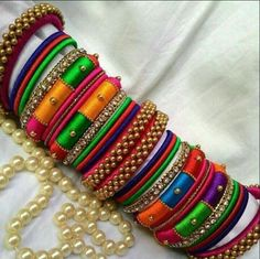 Multicolored Bangles Exclusively Weddings Designed Broad Silk Thread Bangle Designs Its purely handmade products. Whole sellers are also welcome. Its available in all sizes and Silk Thread Bangles Design, Silk Thread Necklace, Silk Bangles, Beaded Necklace Patterns, Thread Jewellery, Textile Jewelry, Jewelry Patterns, Beaded Jewelry, Handmade Jewelry