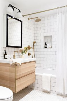 Where I Save and Splurge Adorable bathroom with floating vanity and white tiles for wall and shower by EyeSwoon Bad Inspiration, Bathroom Inspiration, Bathroom Ideas, Bathroom Hacks, Bathroom Inspo, Bathroom Designs, Bathroom Organization, Interior Inspiration, Bathroom Interior Design