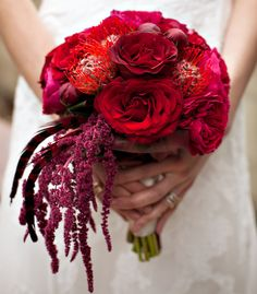 Bouquet in bold reds and purples for a more dramatic winter wedding color scheme. This bouquet features roses, pincushion protea, and hanging amaranthus. Also, it looks like some unopened burgundy peony buds are in there too! Burgundy Wedding, Red Wedding, Floral Wedding, Wedding Hair, Bridesmaid Bouquet, Wedding Bouquets, Frida Kahlo Wedding, Red Flower Arrangements, Winter Wedding Colors