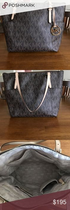 Michael Kors Purse EUC Stunning authentic Michael Kors purse with two deep side pockets. Not used very much!! Excellent condition!! Hardly any signs of wear at all. I only use purses on the weekends and I switch them out often so this one didn't get much use. Approximately 15w 12 l. Michael Kors Bags Shoulder Bags
