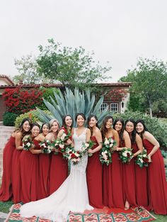 Rich red bridesmaid gowns: http://www.stylemepretty.com/2016/05/27/red-boho-style-ranch-wedding/   Photography: Carmen Santorelli - http://carmensantorellistudio.com/