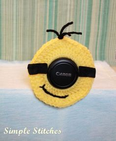 Crochet Minion Camera Lens Buddy by SimpleStitchesLB on Etsy, $10.00