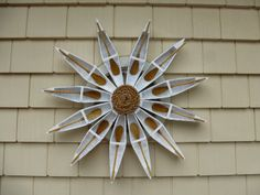 I've been searching for a wreath with a nautical theme, but not overly cutesy or covered in shells. Add bonus points for the vintage-modern starburst shape, and this sure ticks all the boxes! Their other stuff is great, too.   . Canoe Wreath Canoe Nautical Wreath Nautical white by WreathArtists, $89.00