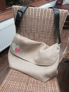 Natural hessian messenger bag. Handmade using an old leather belt as the handle. Pattern retrieved off Pinterest. It was made for a friend who was going on holiday and needed somewhere to put all the kids gadgets.