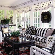 This sunroom is a little bit over-done... but I am such a fan of using different patterns to bring dimension to the room. I love polka dot pillows with bold stripes and checkered accents.