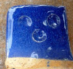 Clear Blue with Kona Feldspar...slow cool 50f/hr from 1800 to 1500f 32.5 EPK.     27.5 ferro frit 3134.  18.8 silica 13 kona feldspar . 5.8 talc   0.5 CMC gum 1.6 cobalt carb.   0.3 rutile