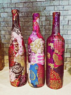 Decoupaged winebottles - would make cool presents when put different sized bottles with candles on a plate or mirror base