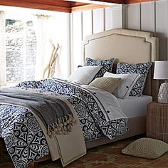 fall serena and lily white wood walls with brown wood ceiling and dirtyish white blanket, catalina bedspread