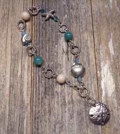 A personal favorite from my Etsy shop https://www.etsy.com/listing/509654879/blue-beach-bracelet