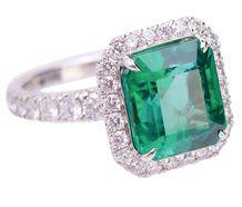 Speaking Volumes - Emerald Diamond Ring