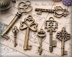 Vintage Style Key Set - 7 Unique Skeleton Keys in Antique Finish Pendants and Charms. $6.00, via Etsy.