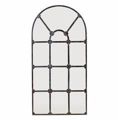 Inspired by the window panes of an 18th century schoolhouse, this arched metal frame mirror with a rust finish creates an instant sense of interest and age wherever it is placed. From Industrial Loft to French Country and beyond, this piece adds light, dimension and character to any space.