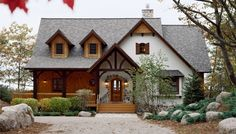 Traditional cottages have a compact footprint, but elements of this style can be applied to larger residences. Exterior design elements might include paned windows, cedar shake siding, bead board paneling, exposed fieldstone and trim pieces such as flower boxes or shutters. Multi-hued exterior finishes complete the look.