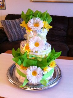 Spring/ gender neutral diaper cake. Green and yellow. #babyshower #diapercake #spring #craftyconjuring