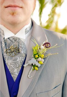 Retro sci fi ray-gun wedding boutonniere. (With extra-credit Octopode tie tack!!)
