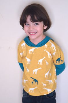How to sew a long sleeve t-shirt with hoodie:Learn how to make an easy long sleeve t-shirt with a hoodie for kids. Step by step sewing tutorial included