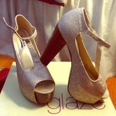 Gold Glitter Heels Gold Glitter Heels. Tie in ankle. Very comfortable in good condition. Small scuff on side of shoe. Normal walking wear on bottom of shoe. Comes with box. Glaze Shoes Heels