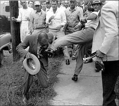 This shows how a grown Black man being forced to kiss the foot of some white fool, while other white a$$holes watch. Segregation was real.