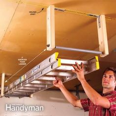 Easy ladder storage.  Threaded rod with pvc cover for apes sire sliding.  Will be too high to take down without another ladder....hmm.... Garage Storage Solutions from The Family Handyman.