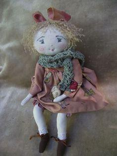 ..quel vent!!!heureusement la tati de Mimi lui a tricoté un beau châle pour partir à l'école..