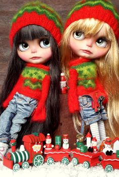 Blythe dolls by KassandraBox on Etsy  Love her dolls and these sweaters?!?!!!! wow Look at those faces.