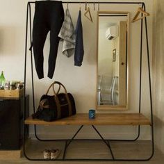 Our Kaehler 1920 Duffle featured in a beautiful clothing rack display  _______________________________ #FortheHome #Kaehler1920 #Men'sFashion #Travel #Leather