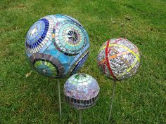 Crystal Thomas' Garden Balls  glass over polystyrene. wrapped in fiberglass mesh and coated with thinset... click and visit her flickr page for more information.