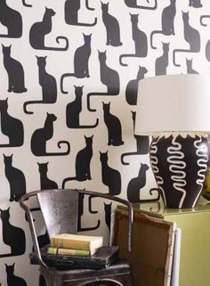 I can't decide if I like this cat wall paper or the cat curtains also featured on this post more. I want them both a lot.