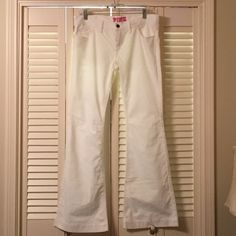 """NWOT VS Pink Winter White Cord Bootcut Jeans 8 Awesome pair of NWOT never worn VS Pink flare Bootcut corduroy jeans. The color is winter white and they are a size 8. They are so soft and comfortable! They have the cute dog logo on the back pocket. 40 1/2"""" long, 32 1/2"""" inseam, 9"""" rise and 17"""" flat across the waist band. PINK Victoria's Secret Jeans Flare & Wide Leg"""