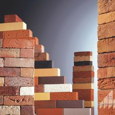 Brick continues to be a leading cladding material in the construction industry thanks to its beauty and inherent ability to be utilized in a variety of unique applications and designs.   #claybrick #brickveneer #brickcladding #brickwall #brickdesign  Clay Roof Tiles, Brick Cladding, Cladding Materials, Brick Design, Brick Wall, Joinery, Range, Wood, Home Decor