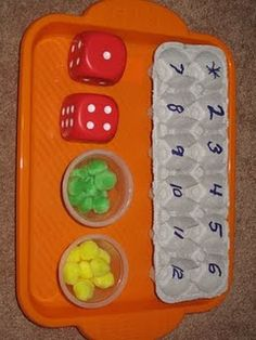 Egg Carton Math - 2 players, roll the dice, add them up and put your colored piece in the appropriate numbered egg hole. First to get one of each number wins. - with multiplication