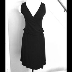 Emporio Armani Cross Front Dress Authentic Black dress with back zipper. Lower skirt area is lined. 100% Viscose. Low cut neckline. See other pics post for more details  Emporio Armani Dresses