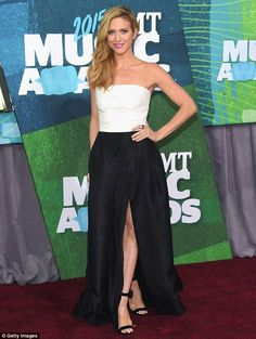 Hitting the high notes: The Pitch Perfect 2 star looked amazing in that gown that consisted of a tight white top and a satiny skirt with thigh-high split