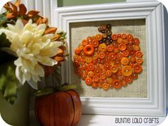 Pumpkin Button Art.  If you want to do it on a larger scale, you could use old puzzle pieces.