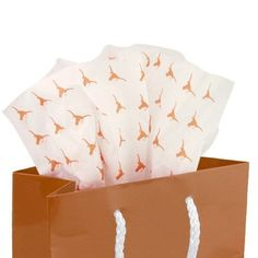 """This team logo print tissue paper is the perfect embellishment for birthday gifts for the avid Longhorn fan in your life. It's also a wonderful way to present the recent grad with a token of congratulations! Each packet includes five 20"""" x 30"""" sheets with an all-over team colored logo print and can be paired with a team logo gift bag for a special touch.   Team logo and colors  20"""" x 30"""" sheets  Five sheets per package  Made in the USA  Officially licensed NCAA product"""
