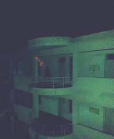 An apparition is caught on a balcony in a building in Thailand, and it appears to have no legs while hovering on the railing.