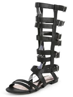 """Put the boots on hold and go for gold in the Arena Caged Gladiator Sandals! Smooth black vegan leather creates twin toe bands and a crisscrossing vamp, then stacks up to the knee with a 14"""" tall caged upper and adjustable pewter buckles. A 13.5"""" zipper at the instep sports a pewter zipper pull. 1/2"""" heel. Lightly padded insole. Non-skid rubber sole. Available in whole and half sizes. Shoe Fit is true to size. Measurements are for a size 6. All vegan friendly, man made materials. Imported."""
