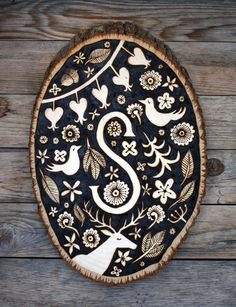 Wood burned Monogram Plaque by Suzette Korduner, via Behance