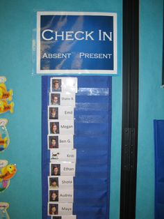 """Best check-in/attendance system ever! I take pictures of the kids, put them on business cards from Avery and print them with their names. I put them in a 2-column pocket chart, and each day the kids move them from """"Absent"""" to """"Present"""". Easy to see who is gone! Kids keep their lunch cards behind their check-in card."""